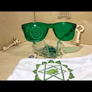 Rainbow Optx Accessories - Green lenses and translucent framed sunglasses